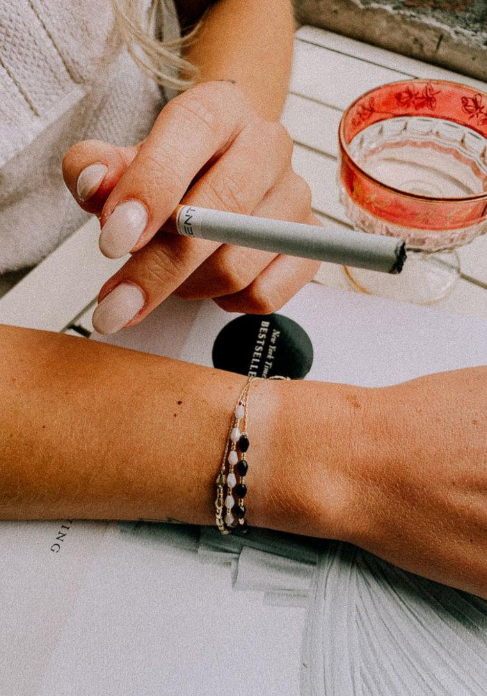 Armband zes kralen paars