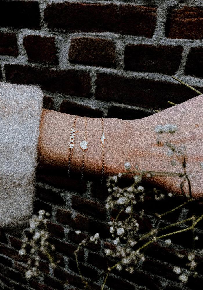 Armband- bliksem Goud