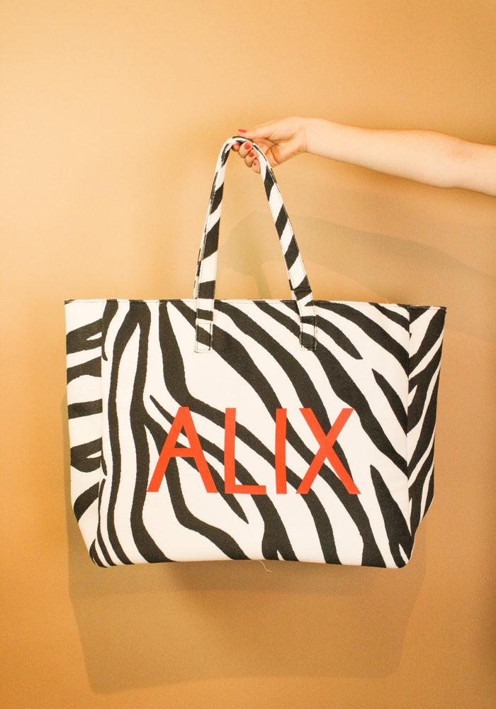 Alix - Ladies woven zebra felted bag