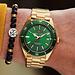 Sem Lewis Lundy Island Diver Uhr goldfarben und grün