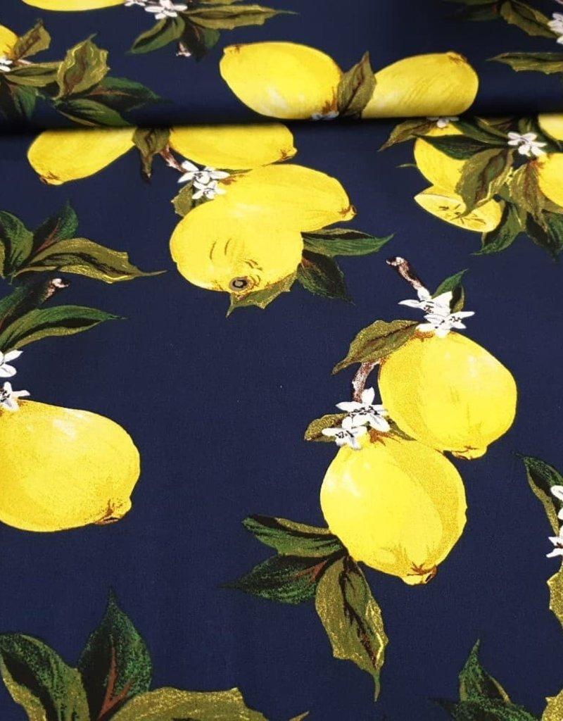 Stof met citroenen, donkerblauwe achtergrond