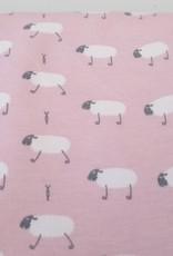 Witte schaapjes op roze achtergrond