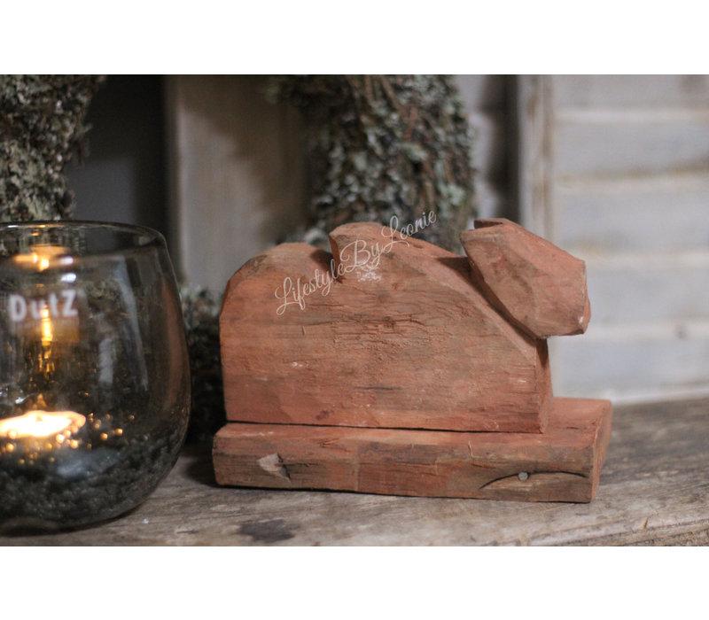 Authentieke houten koe liggend