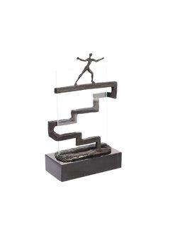 Bronzen beeld De overtreffende trap