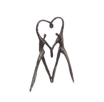 Bronzen beeld Het hart op de juiste plaats