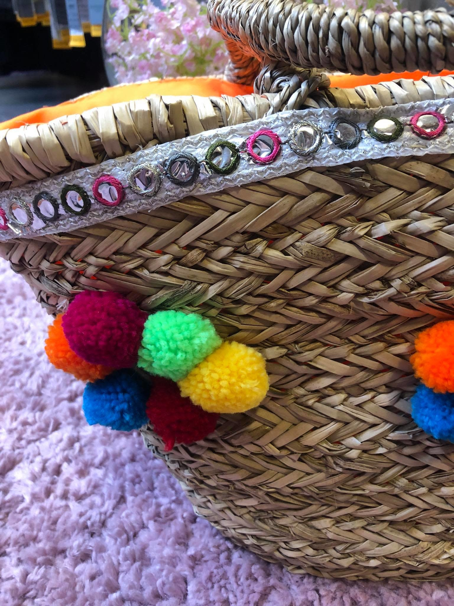 HAND WEAVED BAG WITH COLOURFUL POMPOMS