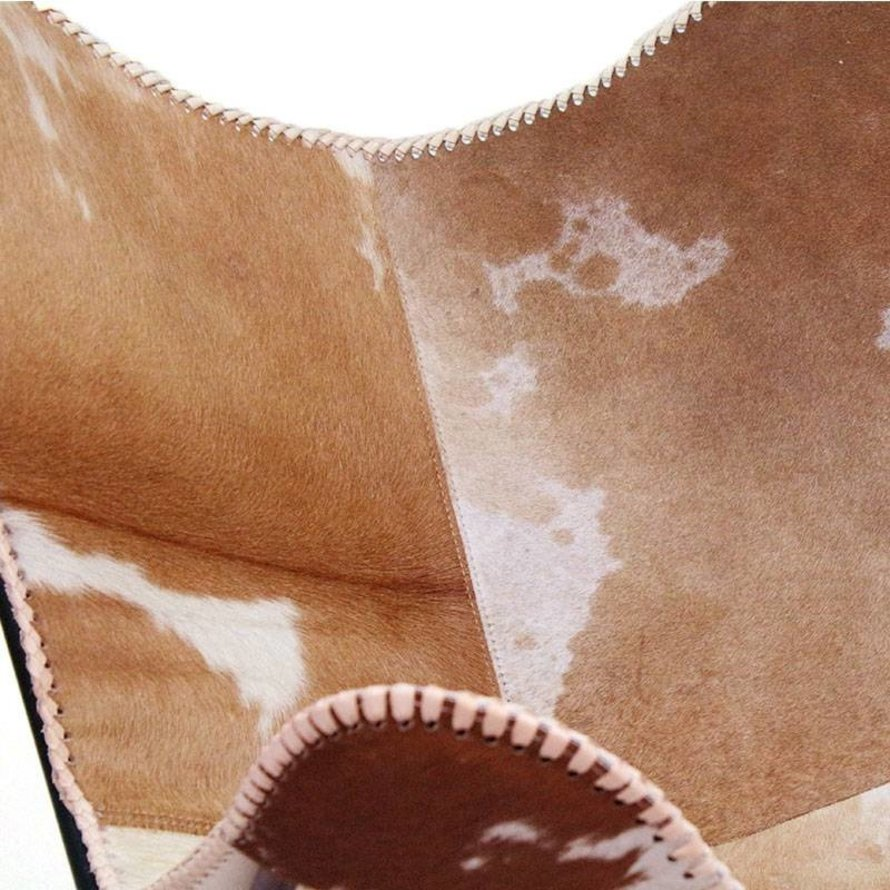 Vlinderstoel Livin cow hair leer