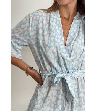 Dotted ruffle playsuit blue