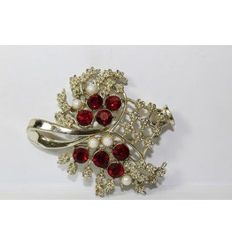 Vintage broche met rode steentjes