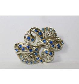 Vintage broche met blauwe steentjes
