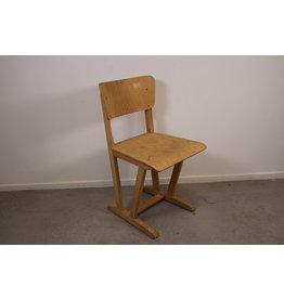Vintage wooden children's school chair from the 1960s