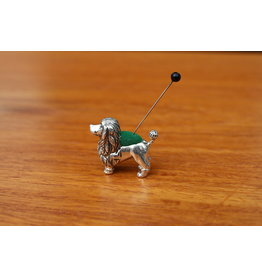 Silver pincushion dog (poodle)