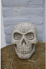 skull concrete skull with flower