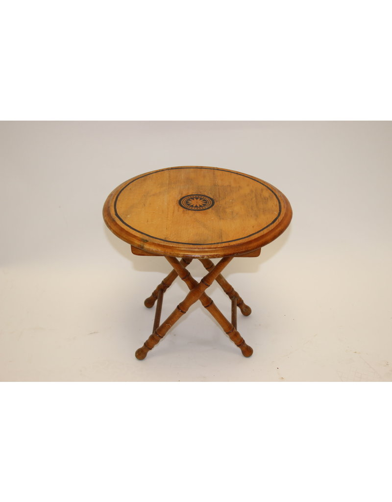 round plant table made of wood