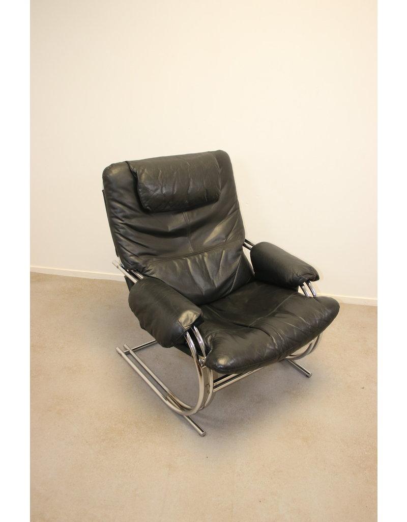 Black leather Design armchair with Chrome stranger