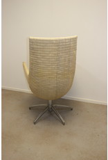 Rattan Design Armchair with star foot 60 years in the style of dirk van Sliedrecht