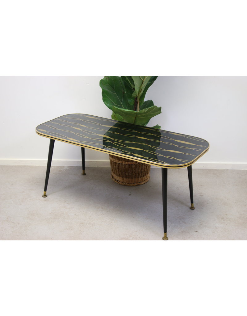 Zwarte glazen koffietafel salontafel met gouden slingers