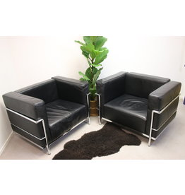 Black leather model Cassina LC3 armchairs