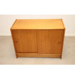 Teak cabinet with sliding doors