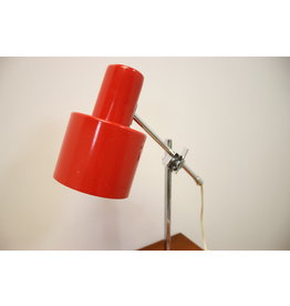 Red and orange desk lamp with chrome steel