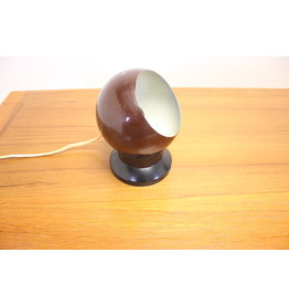 Brown Sphere magnetic light with black base.