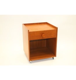 Side table on wheels with drawer.