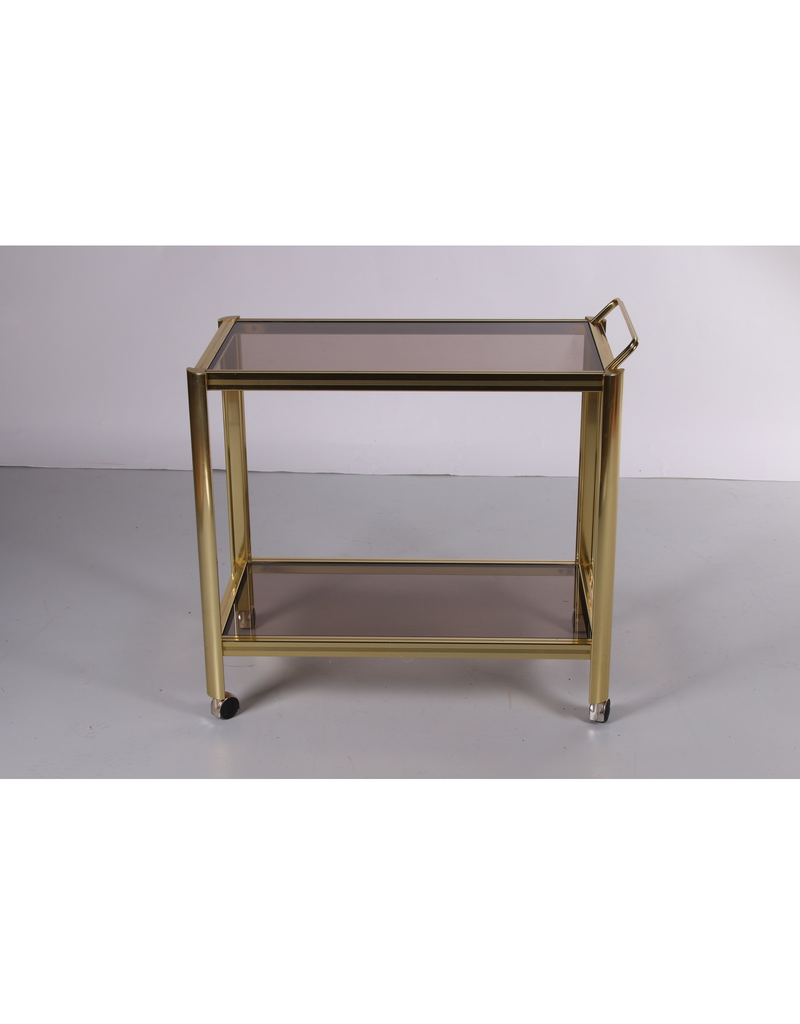 Hollywood Regency trolley met gerookt glas