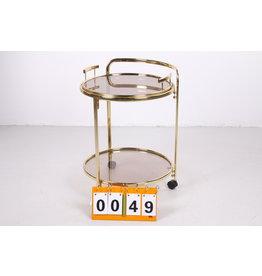 Ronde trolley goud met een Hollywood Regency design