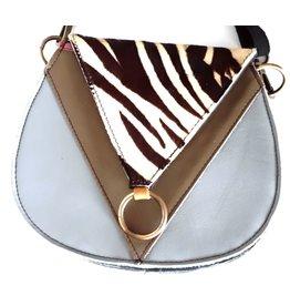 Leren schoudertasje met  zebra print omslag