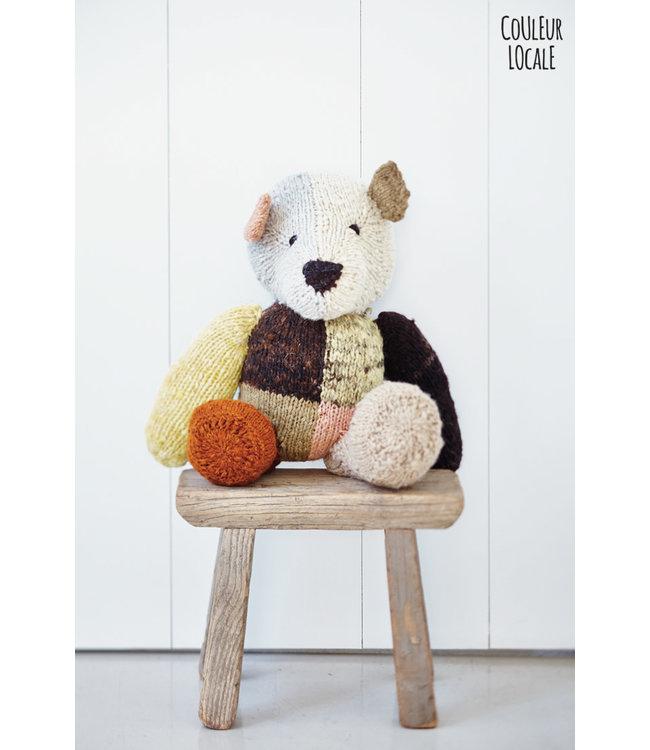 Woolen 'harlequin' bear