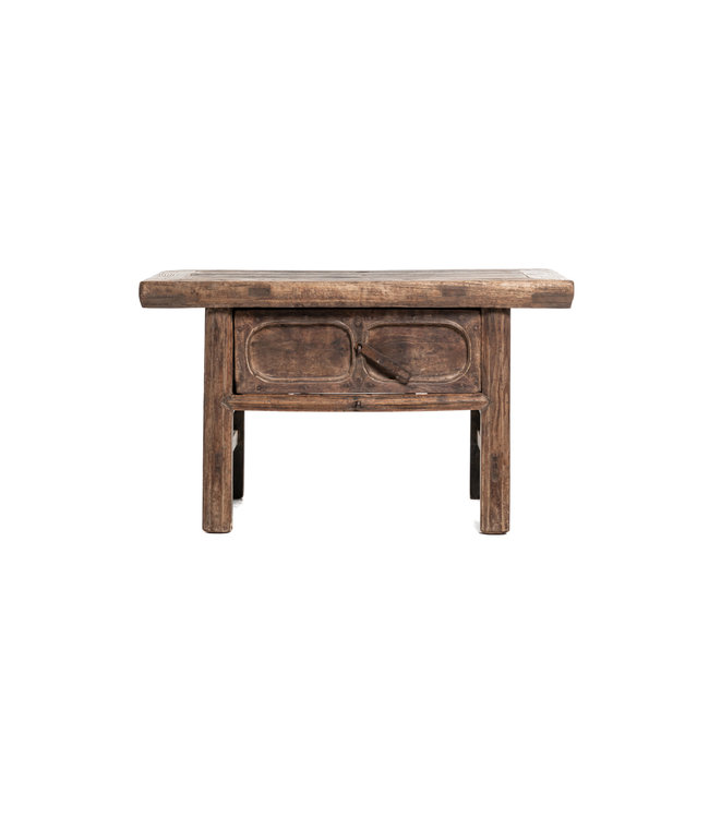 Side table with sculpted drawer