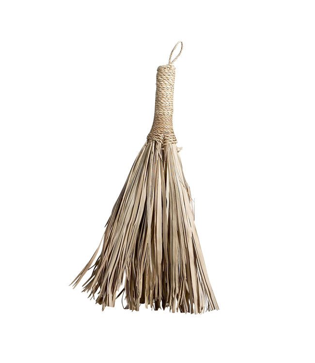 Small broom of palm leaves