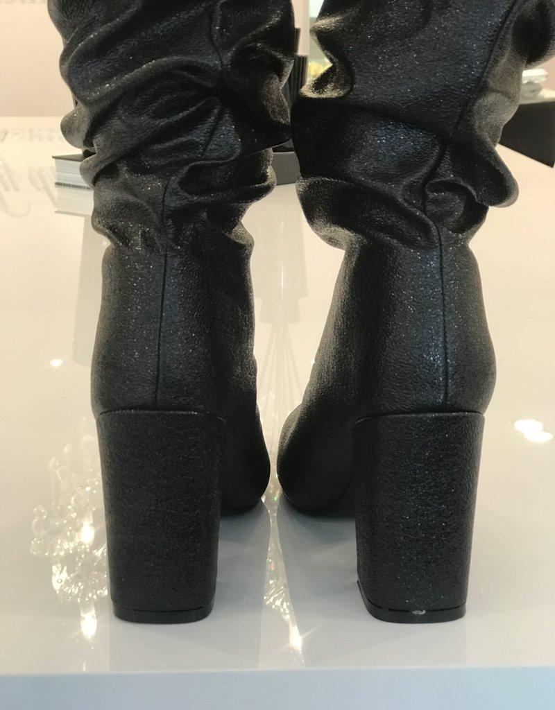 Gedrapeerde laarzen
