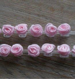 Klemmetjes met rose roosjes (12)