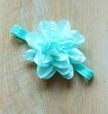 Zeegroen haarbandje met bloem