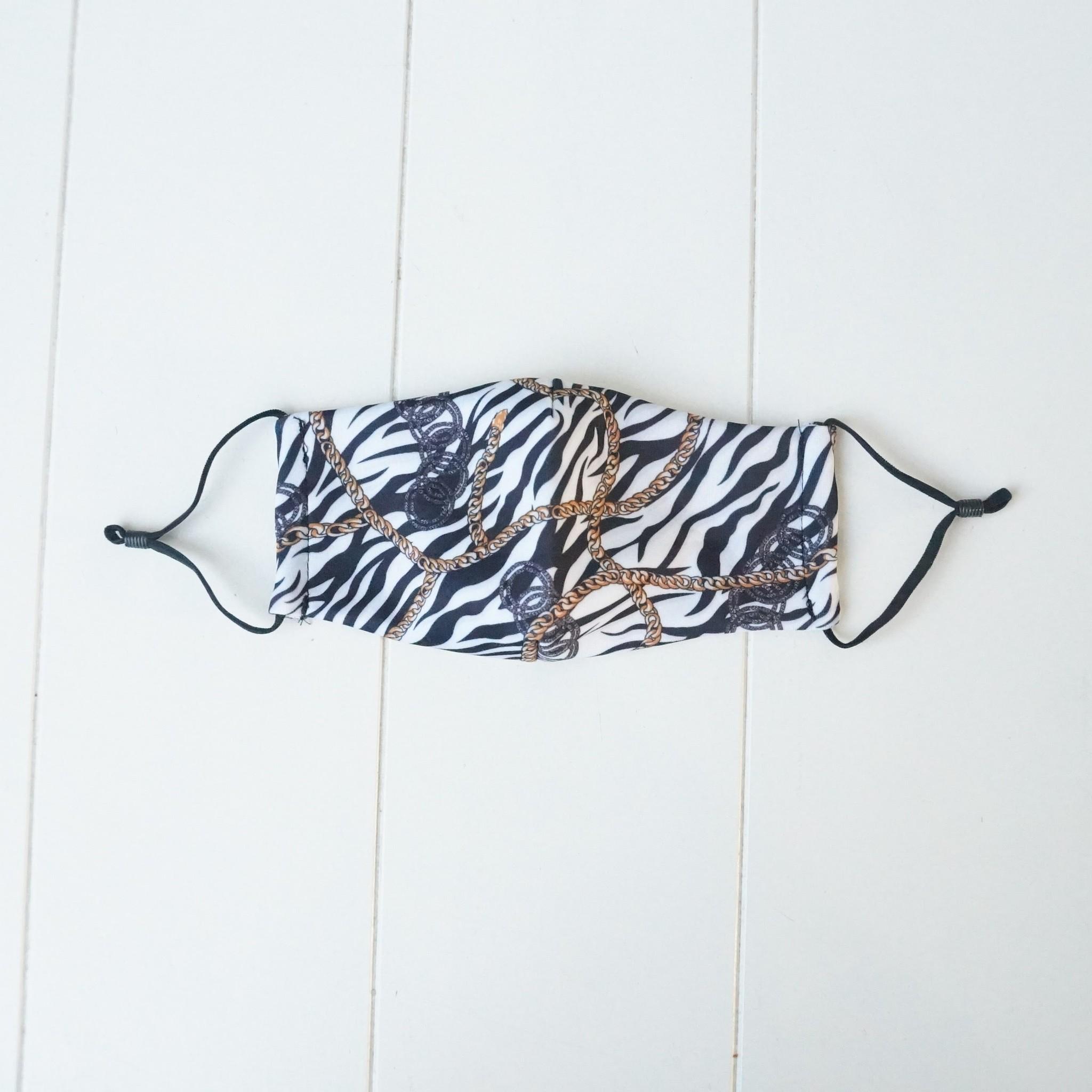 Wit mondkapje met zebraprint