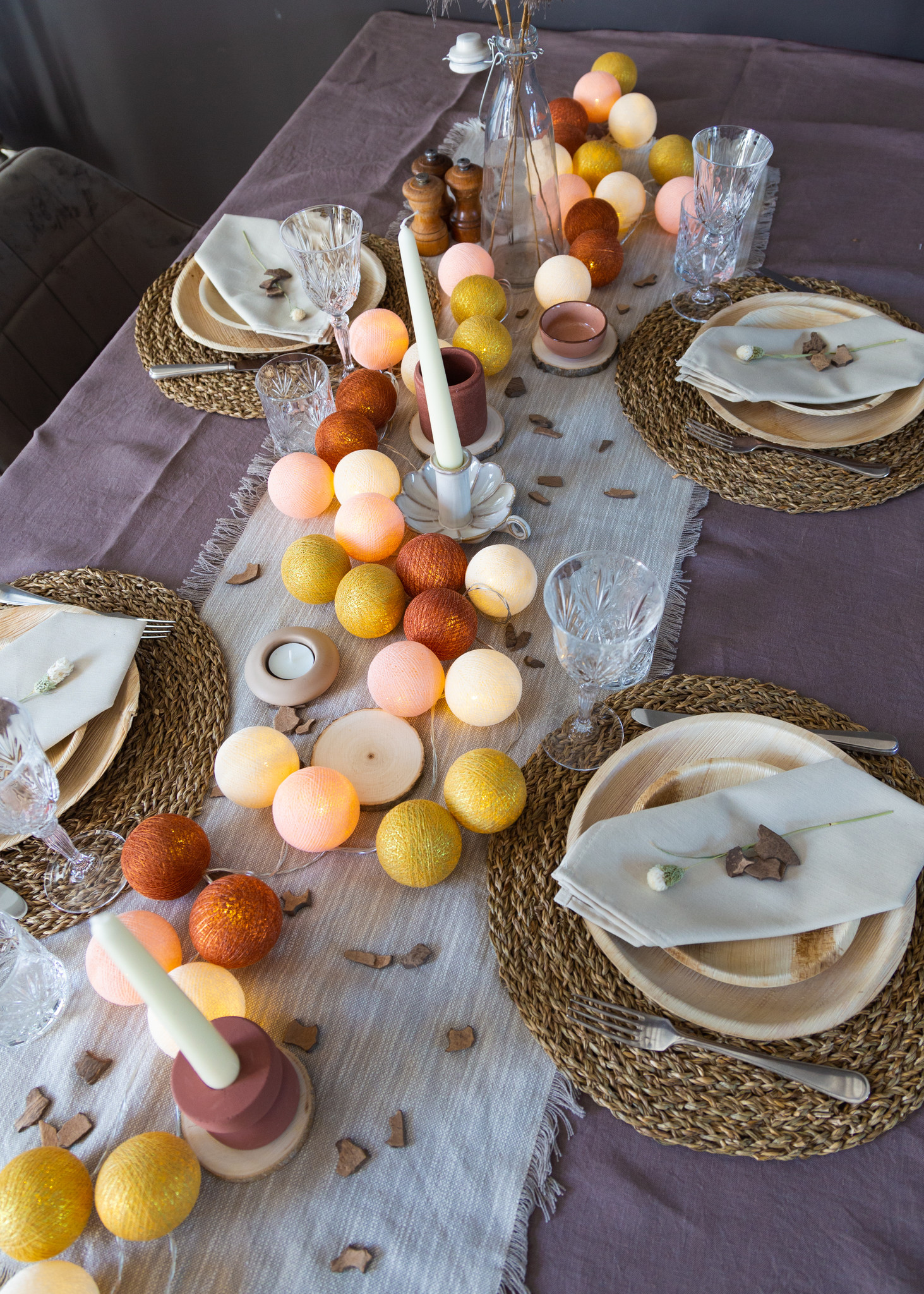 How do you create a cozy table setting during the holidays?
