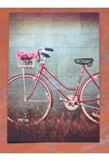 Nostalgische kaart - fiets tegen het muurtje