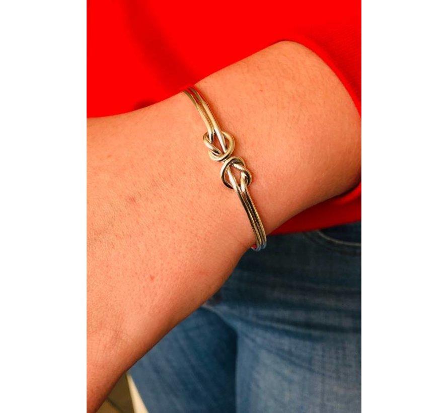 Zilveren sierlijke knoop klemarmband
