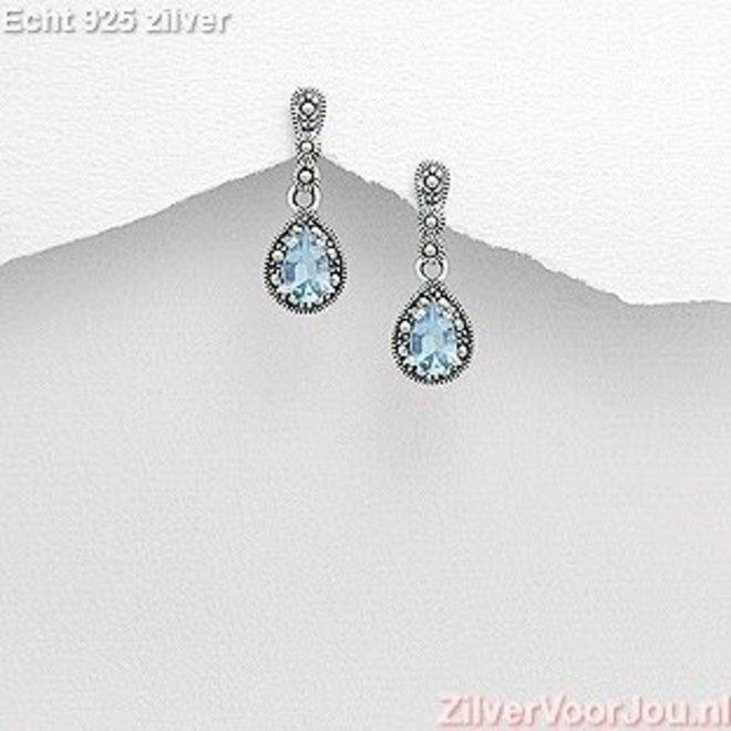 Zilveren sierlijke marcasiet blauwe zirkonia oorstekers