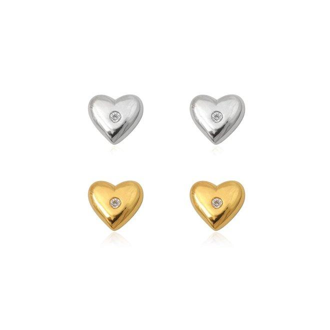 Zilveren en geel goud verguld paar hartjes oorstekers met witte zirkoon