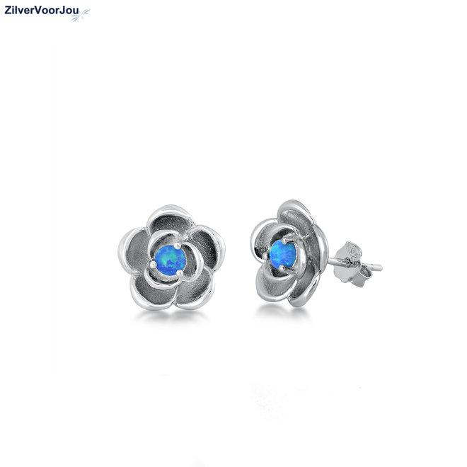 Zilveren blauwe opaal bloem oorstekers rhodium