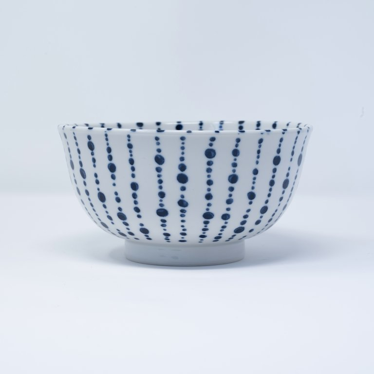 White bowl with blue lines and dots 16cm x 9cm