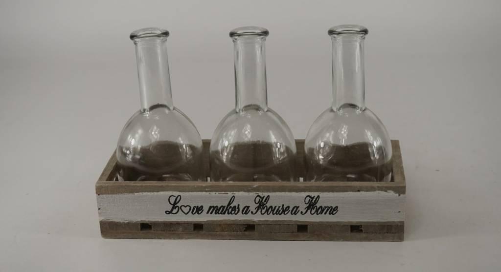houten tray met 3 flessen en tekst