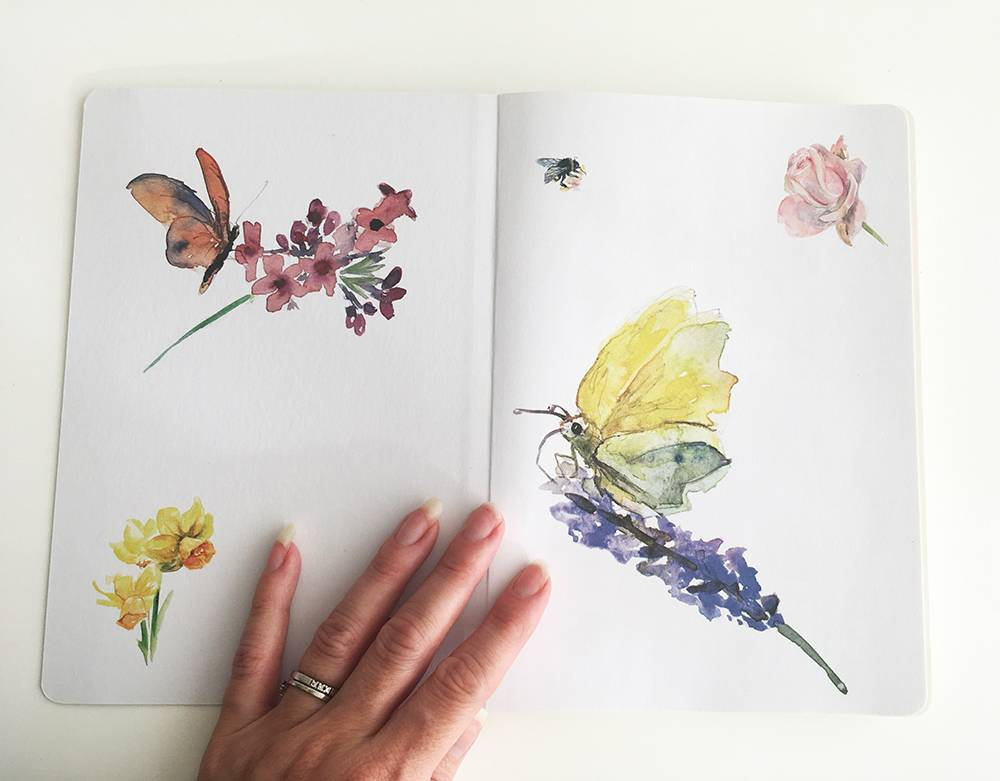 Notebook A5 with illustrations of butterflies and flowers