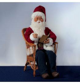 MultiAnimation Kerstman zittend op stoel, een boek lezend