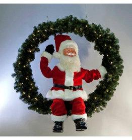 MultiAnimation Kerstman zittend in een dennenkrans met lichtjes