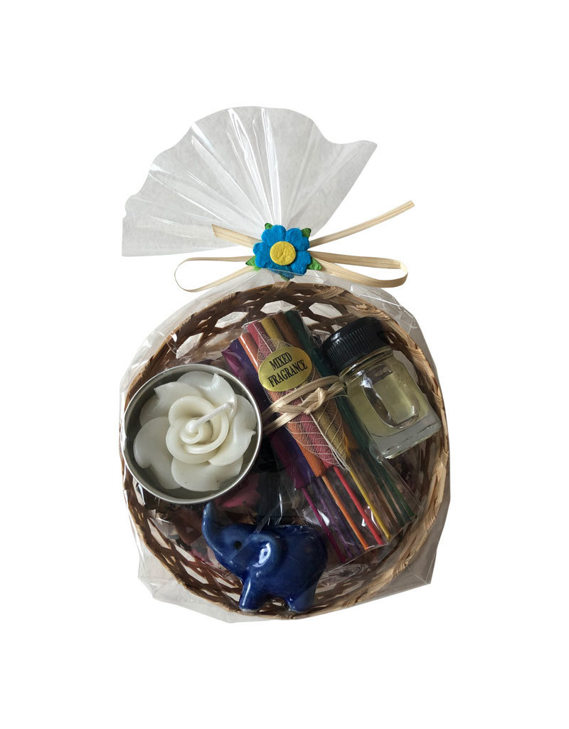 basket with dried flowers and incense