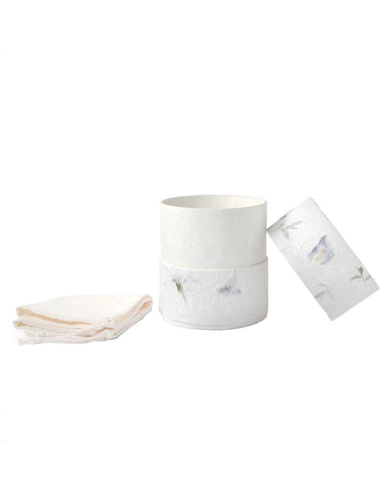 . Eco urn covered with natural paper with flowers