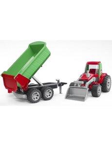 Tractor met voorlader en aanhanger